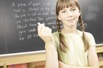 Girl in front of blackboard