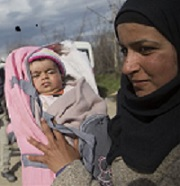picture of migrant mother and child at border crossing