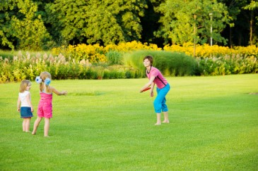 Fun Family Fitness, Mom throwing frisbee to kids outside