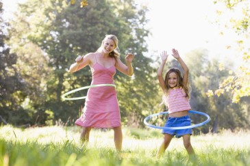 Fun Family Fitness, Mom and girl hula hooping outside for exercise