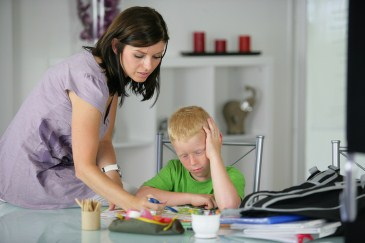Homework help, mother helping young son