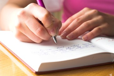 ADHD tips for parents, woman writing in journal