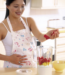 Pregnant woman making smoothie