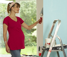 Pregnant woman painting room