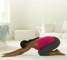 woman doing prenatal back stretch