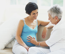 pregnant woman talking with mother