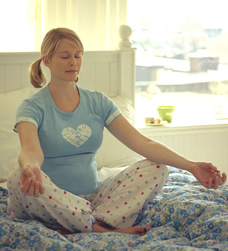 pregnant woman relaxing with yoga