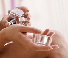 woman putting on perfume