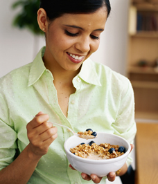 pregnant woman eating healthy cereal
