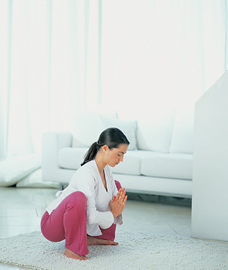 pregnant woman in squatting yoga pose