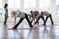 Woman in group exercise class