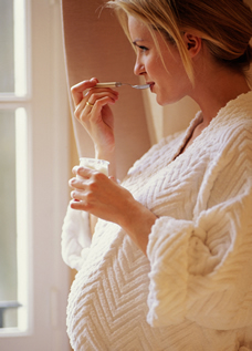 Pregnant woman eating yogurt