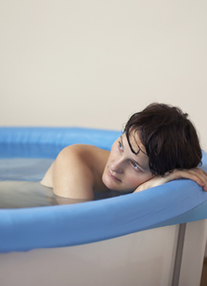 Woman in birthing pool