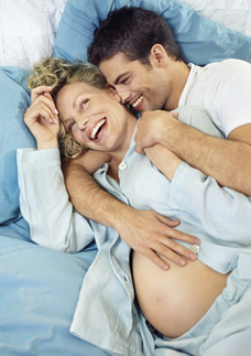Man and pregnant woman laughing