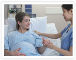 Pregnant woman in labor and delivery room at hospital