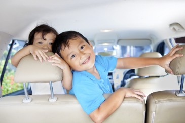 Tips for Road Trips and Car Travel with Kids, brother and sister siblings in car backseat