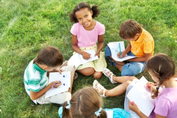 Summer camp essentials, camp kids writing letters or journaling on paper