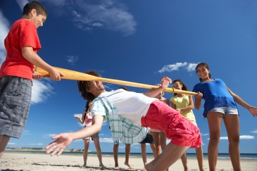 teen limbo contest on beach