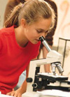 Intermediate student with microscope