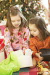 Kids opening Christmas presents