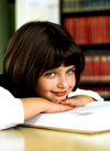 Young girl smiling in library