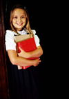 Young girl holding books