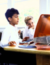 Boys reading on computer