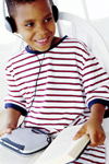 Boy with headphones, cd player, and book