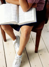 Student with book on lap /></td> <td width=