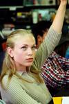 Girl raising her hand in class