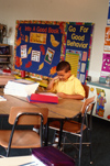 Boy sitting in elementary classroom