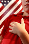 Boy pledging allegiance to US Flag