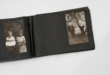 Antique photo album on white background