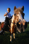 Boy horseback riding