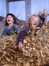 Students jumping in leaves