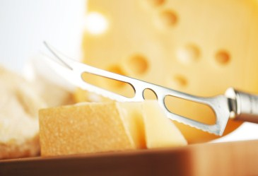 Cheese knife and block of cheese