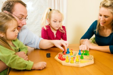 NewYearsResolution,familyplayingboardgametogether
