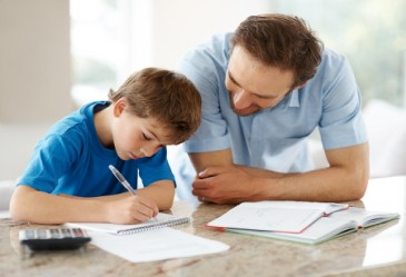 Father helping his young son with homework