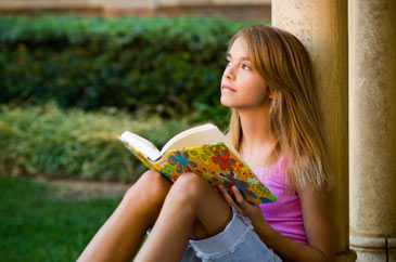 Girlreadingbook,daydreaming