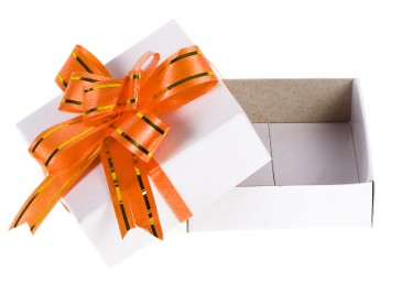 Halloween candy leftovers, white gift box with orange bow