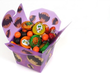 Halloween candy leftovers, party favor goody box filled with Halloween candy