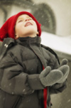 Boy outside in snow
