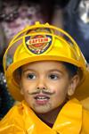 Boy dressed as fireman