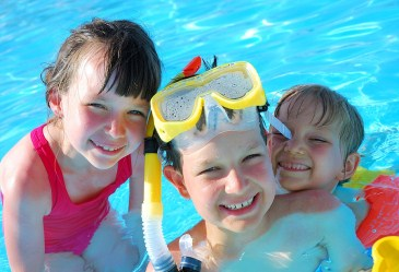 Group of kids smiling in pool