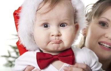 baby wearing Santa hat