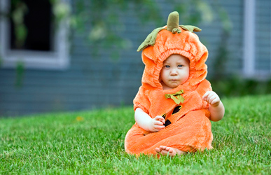 boy in pumpkin Halloween costume