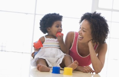 Little Girl and Mother Playing with Blocks