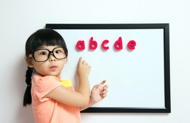 Young girl learning her ABCs