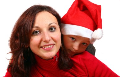 mother and child wearing Santa hat