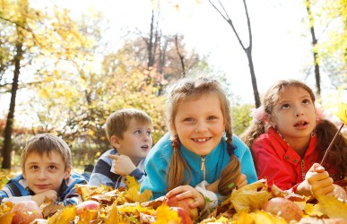 kids playing in autumn leaves